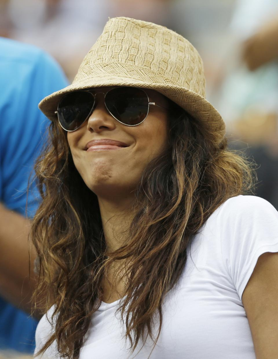 Eva Longoria watches a semifinal match between Serena Williams and Italy's Sara Errani at the 2012 US Open tennis tournament, Friday, Sept. 7, 2012, in New York. (AP Photo/Darron Cummings)