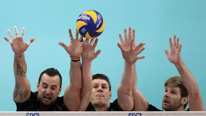 Germany's Grozer Boehme and Schwarz block shot from France's Ngapeth in third place match at Volleyball Men's World Championship in Katowice