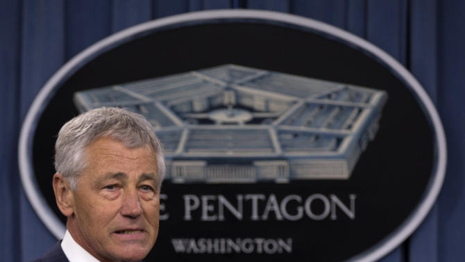 New Defense Secretary Chuck Hagel arrives at a news conference regarding the automatic spending cuts, Friday, March 1, 2013, at the Pentagon. (AP Photo/Carolyn Kaster)