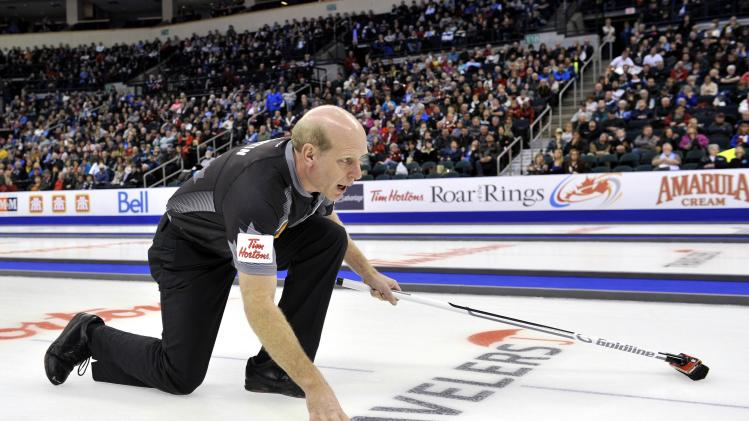 Skip Martin gives instructions to his sweepers against Team Morris during the men's semi-final at the Roar of the Rings Canadian Olympic Curling Trials in Winnipeg
