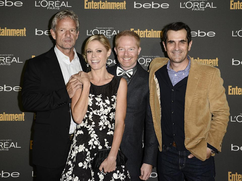 From left to right, Modern Family co-creator Christopher Lloyd, actress Julie Bowen, actor Jesse Tyler Ferguson, and actor Ty Burrell arrive at the 2013 Entertainment Weekly Pre-Emmy Party at Fig & Olive on Friday, Sept. 20, 2013 in Los Angeles. (Photo by Dan Steinberg/Invision/AP)