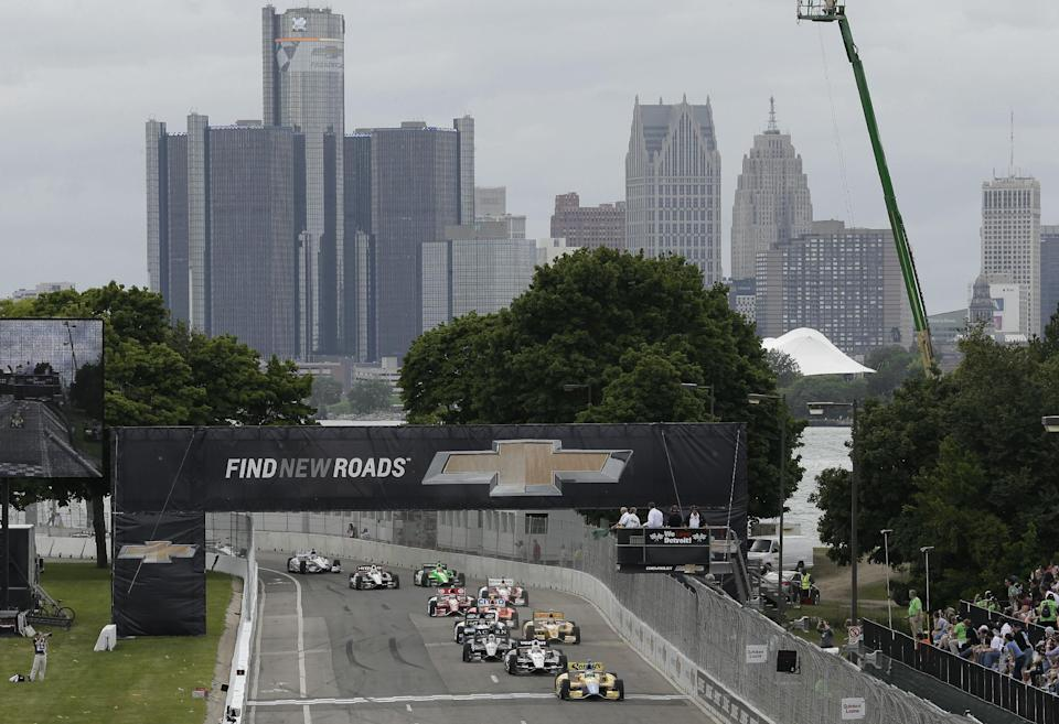 Mike Conway leads the field to the start line during the IndyCar Detroit Grand Prix auto race on Belle Isle in Detroit, Sunday, June 2, 2013. (AP Photo/Paul Sancya)