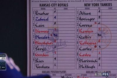 Royals post Astros lineup in dugout on a card with the Yankees logo