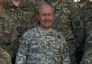 <p>Chairman of the US Joint Chiefs of Staff, General Martin Dempsey with troops at the International Security Assistance Force (ISAF) headquarters in Kabul on August 20. A rocket fired on a US airbase in Afghanistan early Tuesday damaged the aircraft of America's top military officer and wounded two maintenance crew, officers said.</p>