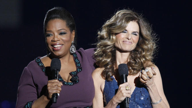 "Maria Shriver appears with Oprah Winfrey during a star-studded double-taping of ""Surprise Oprah! A Farewell Spectacular,"" Tuesday, May 17, 2011, in Chicago. ""The Oprah Winfrey Show"" is ending its run May 25, after 25 years, and millions of her fans around the globe are waiting to see how she will close out a show that spawned a media empire. (AP Photo/Charles Rex Arbogast)"