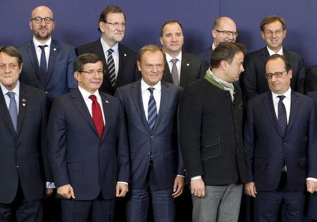 Turkish Prime Minister Ahmet Davutoglu poses with European Union leaders during a group photo at an EU-Turkey summit in Brussels