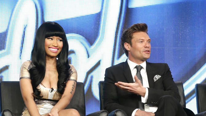 "On Tuesday, Jan. 8, 2013 photo, Nicki Minaj, left, and Ryan Seacrest from ""American Idol"" attend the Fox Winter TCA Tour at the Langham Huntington Hotel, in Pasadena, Calif.  ""American Idol"" returns on Wednesday, Jan. 16, 2013, for Season 12 on FOX. (Photo by Todd Williamson/Invision/AP)"