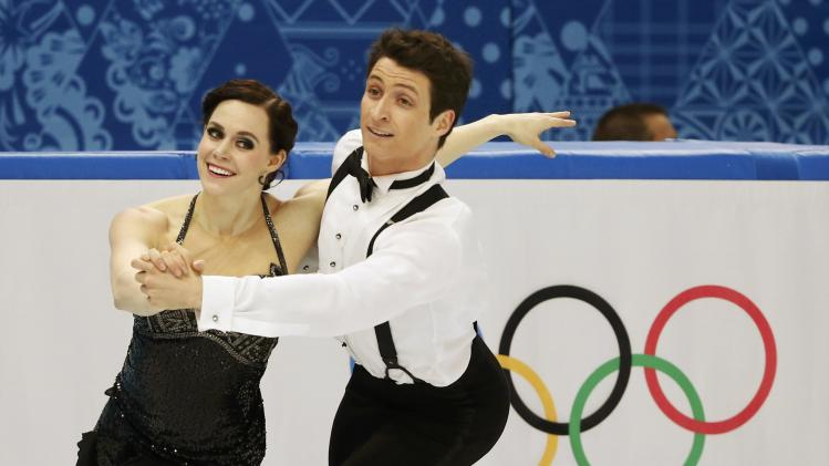 Canada's Tessa Virtue and Scott Moir compete during the Figure Skating Ice Dance Short Dance Program at the Sochi 2014 Winter Olympics