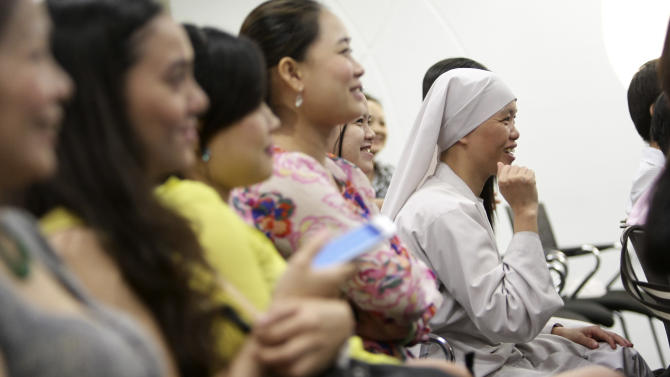 In this photo taken on Oct. 19, 2012, a Vietnamese Buddhist nun among economic students listens during a presentation by Nu Skin, a multilevel marketing company, at its office in Ho Chi Minh City, Vietnam. Nu Skin, which has stormed through Asia over the last two decades, racked up huge profits despite regulatory scrutiny over its marketing practices and the efficacy of the products that it sells. Multilevel marketing businesses have a strained history in China and Vietnam, whose Communist rulers have been wary of pyramid-based sales schemes that have been characterized by some as preying on the dreams of poor citizens. They also fear that unrest as a result of associated scams from the schemes could challenge their legitimacy. (AP Photo/Na Son Nguyen)