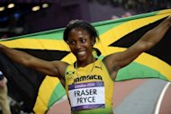 Jamaica's Shelly-Ann Fraser-Pryce waves her national flag after winning the silver medal in the women's 200m final at the athletics event of the London 2012 Olympic Games, on August 8. Fraser-Pryce finished with the personal best time of 22.09sec