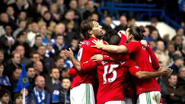 Swansea City players surround Michu (L) after he scored the opening goal against Chelsea (AFP)