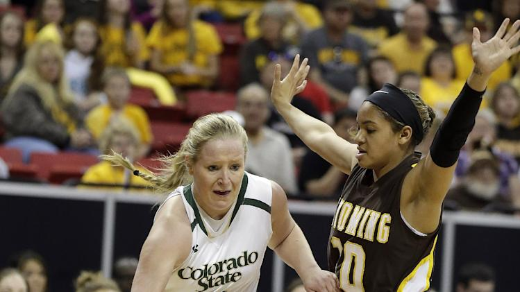 Wyoming's Marquelle Dent, right, defends as Colorado State's Gritt Ryder drives during the first half of a NCAA college basketball game in the semifinals of the Mountain West Conference tournament Friday, March 14, 2014, in Las Vegas. (AP Photo/Isaac Brekken)