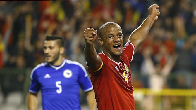Belgium's Vincent Kompany reacts after his teammate Marouane Fellaini scored during their Euro 2016 qualification match against Bosnia at the King Baudouin stadium in Brussels