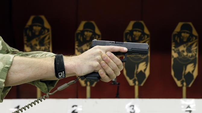 A Glock 17 Gen 4 pistol is demonstrated during a media opportunity at the Royal Artillery Barracks in London, Wednesday, Jan. 9, 2013. The defense ministry has signed a 9 million pound ($13.6 million) contract to provide the Armed Forces with more than 25,000 new Glock sidearms. (AP Photo/Kirsty Wigglesworth)