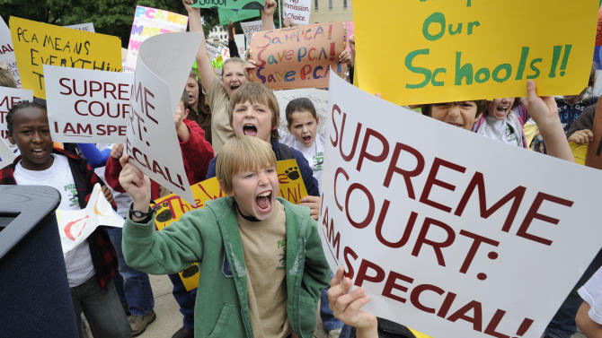Joe Worsley, 9, front and center with fellow students from Pataula Charter Academy in Edison, Ga., protests a ruling by the state's supreme court that overturned a law that allowed the creation of state approved charter schools, during a rally in front of the capitol, Tuesday, May 17, 2011, in Atlanta. (AP Photo/John Amis)