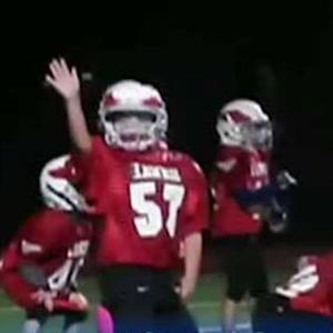 Pee wee football players break into dance mid-game