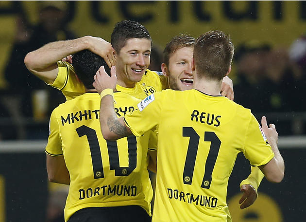 Dortmund's Robert Lewandowski of Poland, second left, celebrates with teammates after scoring during the German first division Bundesliga soccer match between  BvB Borussia Dortmund and VfB Stuttgart