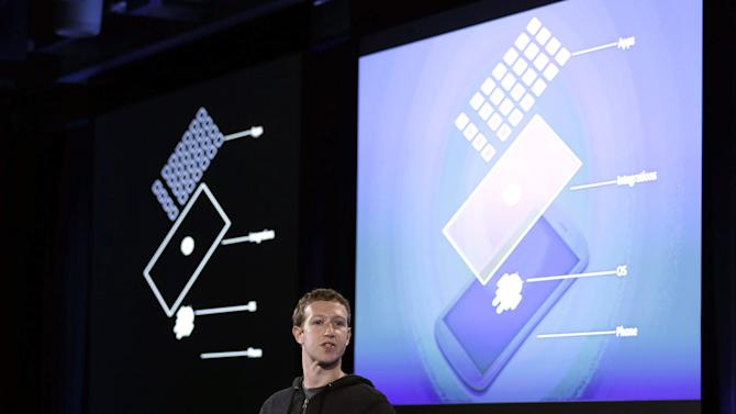 Facebook CEO Mark Zuckerberg speaks at the company's headquarters in Menlo Park, Calif., Thursday, April 4, 2013. Zuckerberg says the company is not building a phone or an operating system. Rather, Facebook is introducing  a new experience for Android phones. The idea behind the new Home service is to bring content right to you, rather than require people to check apps on the device.   (AP Photo/Marcio Jose Sanchez)