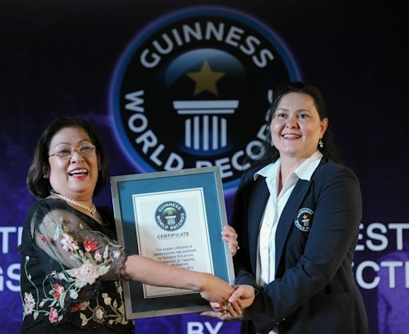 Georgina Gil-Lacuna (L), Philippine Guiness World Record holder of the largest collection of jigsaw puzzles in Tagaytay City, south of Manila on November 29, 2012