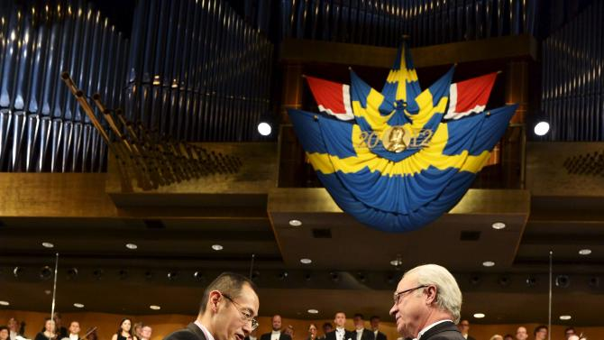 The 2012 Nobel Prize Laureate for Physiology or Medicin Professor Shinya Yamanaka, left, of Japan receives his Nobel Prize from Sweden's King Carl XVI Gustaf during the Nobel Prize award ceremony at the Stockholm Concert Hall in Stockholm, Sweden Monday, Dec. 10, 2012. The Nobel awards are always awarded on Dec. 10, the anniversary of Alfred Nobel's death in 1896. The prizes for laureates in medicine, chemistry, physics and literature are awarded in the Swedish capital Stockholm, whilst the Nobel Peace Prize is awarded on the same day in Oslo, Norway. (AP Photo/Jonas Ekstromer, Pool)