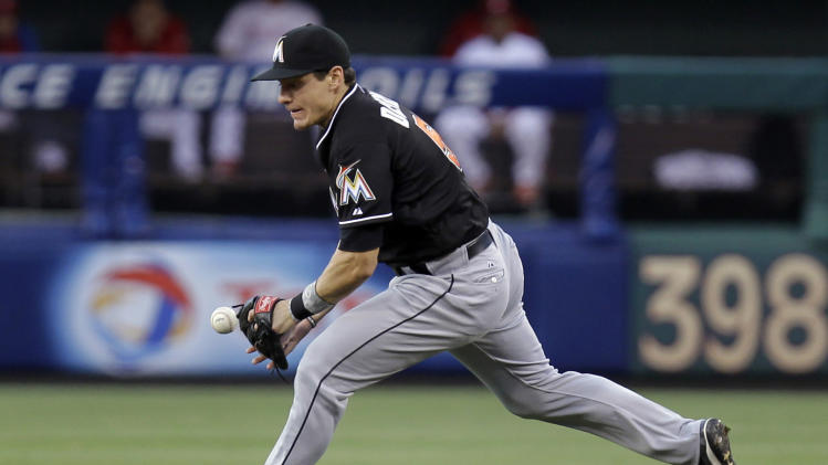 Miami Marlins second baseman Derek Dietrich bobbles the ball on a hit by Philadelphia Phillies' Michael Young in the fourth inning of a baseball game, Tuesday, June 4, 2013, in Philadelphia. (AP Photo/Laurence Kesterson)