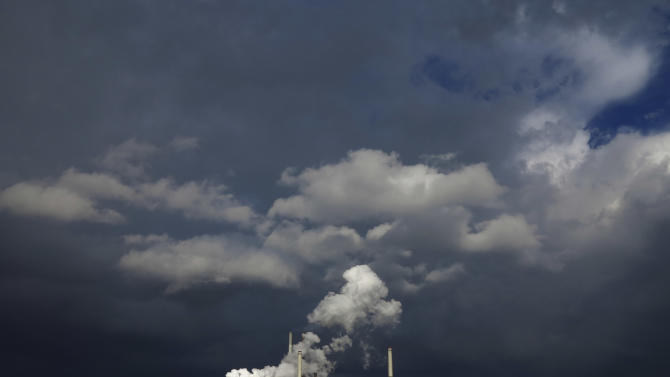 FILE - The Sept. 19, 2012 file photo shows dark clouds filling the sky after a rain shower, behind the ThyssenKrupp Kokerei Schwelgern steel plant on the river Rhine in Duisburg, Germany. Germany's economy grew by 0.7 percent in 2012 _ but the economy shrank in the fourth quarter, government figures showed Tuesday, Jan. 15, 2013. The country's economy grew at faster pace in 2012 than the rest of the group of 17 European Union countries that uses the euro, which has been hit by a debt crisis. But the numbers were down on the previous year, when the Germany's economy grew 3.0 percent. (AP Photo/Frank Augstein, file)