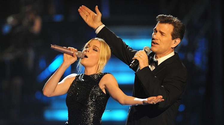 LeAnn Rimes and Chris Isaak onstage during the 2009 MTV Movie Awards held at the Gibson Amphitheatre on May 31, 2009 in Universal City, California.