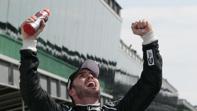 Jimmie Johnson celebrates after winning the NASCAR Sprint Cup Series Brickyard 400 auto race at the Indianapolis Motor Speedway in Indianapolis, Sunday, July 29, 2012. (AP Photo/AJ Mast)