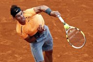 Spain&#39;s Rafael Nadal hits a return to Kazakhstan&#39;s Mikhail Kukushkin during the Monte-Carlo ATP Masters Series Tournament tennis match, in Monaco. Nadal won 6-1, 6-1 in exactly one hour
