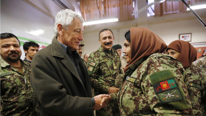 U.S. Secretary of Defense Chuck Hagel, center left, shakes hands with a female Afghan non-commissioned officer under training, during his visit to the Kabul Military Training Center in Kabul, Afghanistan, Sunday, March 10, 2013. Hagel is on his first trip to Afghanistan as defense secretary. (AP Photo/Jason Reed, Pool)