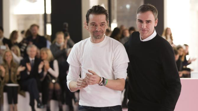 Belgian designer Raf Simons appears at the end of his Autumn/Winter 2015/2016 women's ready-to-wear collection for fashion house Christian Dior during Paris Fashion Week