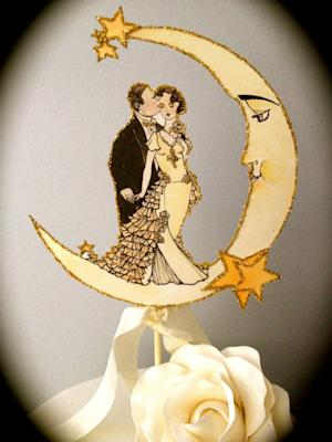 "This photo provided by Jolie En Rose Vintage shows illustrator and designer Kris Shoemaker's 1920s style paper embellishments as a cake topper that she created for a vintage style wedding. It is available at www.etsy.com/JolieEnRoseVintage. She says, ""The glamorous, celebratory nature of the Jazz Age evokes a romantic yet modern wedding theme that touches upon a playful nostalgia for this spirited era."" (AP Photo/Jolie En Rose Vintage, Kris Shoemaker )"