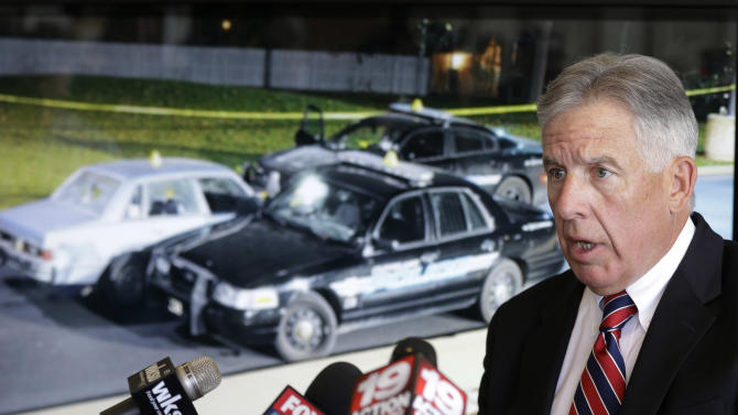 Cuyahoga County Prosecutor Tim McGinty makes a statement regarding the grand jury announcement of the deaths of Timothy Russell and Malissa Williams Friday, May 30, 2014, in Cleveland. A grand jury on Friday indicted six police officers involved in a November 2012 car chase that ended in the deaths of two unarmed people, was decried by critics as a racially motivated execution and is part of a wide-ranging federal investigation. The grand jury indicted a patrol officer on two charges of manslaughter and five supervisors on charges of dereliction of duty for failing to control the chase. (AP Photo/Tony Dejak)