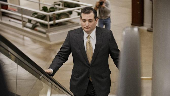 Sen. Ted Cruz, R-Texas arrives on Capitol Hill in Washington, Wednesday, Feb. 12, 2014, as senators go to the chamber for a vote to extend the Treasury's borrowing authority. Setting the vote in motion was one of Senate Republican leader Mitch McConnell's Republican colleagues, Cruz, the tea party darling who has caused heartburn for his GOP colleagues in his year in the Senate. Cruz insisted on a 60-vote threshold for the Senate to proceed to legislation to allow the government to borrow money to pay its bills. (AP Photo/J. Scott Applewhite)