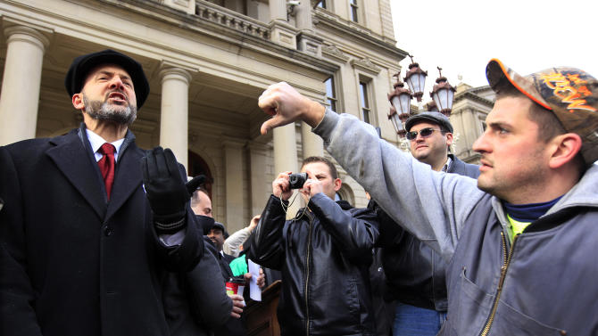 Police spray pro-union protesters at Mich. Capitol