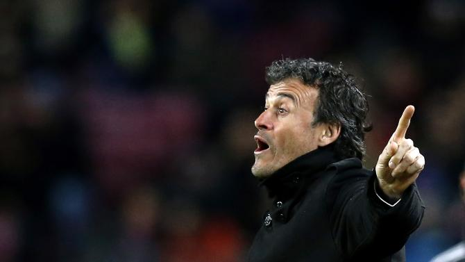 Barcelona's coach Luis Enrique gestures to his players during their Spanish first division soccer match against Villareal at Nou Camp stadium in Barcelona