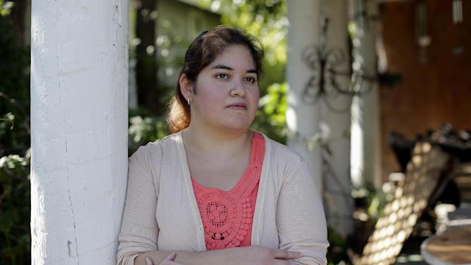 In this photo taken Friday, Sept. 13, 2013, Annette Guerra posses for a photo at her home in San Antonio. Guerra, 33, has been looking for a full-time job for more than a year after finishing nursing school. An analysis of government data conducted for The Associated Press lays bare a grim reality for middle class and lower-income families: middle-income workers in the persistently weak economy have increasingly been pushed into lower-wage jobs. Many of them in turn are displacing lower-skilled, low-income workers formerly in those positions, who become unemployed or are forced to work fewer hours than desired. (AP Photo/Eric Gay)