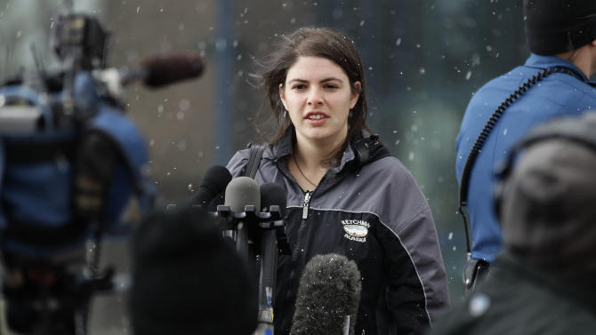 Jessica Watts, whose cousin was killed in the Aurora movie theater shooting, speaks with members of the media following a court proceeding for Aurora theater shooting suspect James Holmes, at the courthouse in Centennial, Colo., on Friday, Jan. 11, 2013. On Friday, the Holmes arraignment hearing was postponed to March 12. Judge William Sylvester ruled after the hearing that Holmes will stand trial on 166 felony charges, including murder and attempted murder.  (AP Photo/Brennan Linsley)