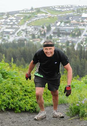 File - In this July 4, 2012 file photo provided by TSS Photography, 65-year-old Michael LeMaitre competes in the Mount Marathon race in Seward, Alaska. LeMaitre disappeared in the race. The rookie's disappearance during a popular extreme race on the mountain has led to new significant new rules in this year's event. Runners in the July Fourth race have to go halfway up Mount Marathon in an hour or they will have to turn around and participants also must sign a statement saying they've completed the entire race course all the way up the 3,022-foot peak.Organizers say the changes were prompted by the disappearance of LeMaitre, who was slower than average in his first time on the mountain. (AP Photo/TSS Photography, Davis Stewart, File)