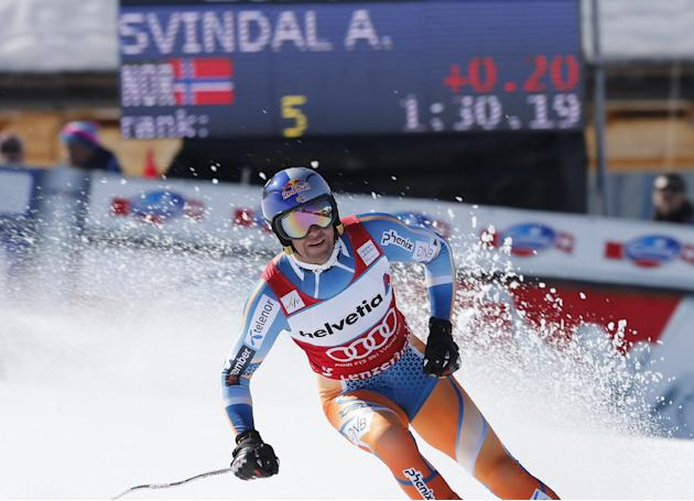 Norway's Aksel Lund Svindal arrives to take fifth place in the men's alpine skiing downhill at the World Cup finals in Lenzerheide, Switzerland, Wednesday, March 12, 2013. Aksel Lund Svindal r
