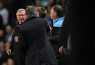 "Manchester United manager Alex Ferguson (left) and his Manchester City counterpart Roberto Mancini (2nd left) exchange words during the Premier League match at the Etihad stadium in Manchester. Ferguson accused Mancini of ""badgering"" officials after a furious touchline bust-up with the Manchester City boss"