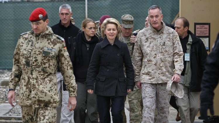 Newly appointed German Defence Minister Ursula von der Leyen and ISAF commander General Joseph Dunford, arrive for press briefing in Mazar-i-Sharif