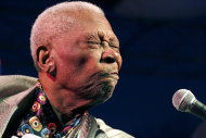 In this Aug. 22, 2012 photograph, ever a showman, an 86-year-old B.B. King thrills a crowd of several hundred people at the 32nd annual B.B. King Homecoming, a concert on the grounds of an old cotton gin where he worked as a teenager many years ago, in Indianola, Miss. Now the place_ the B.B. King Museum and Delta Interpretive Center _ is a monument to him and the blues. (AP Photo/Rogelio V. Solis)