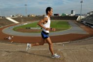 Cambodia's best long-distance runner Hem Bunting during a training session at the National Olympic stadium in Phnom Penh. Cambodia has selected an eccentric Japanese comedian to compete in the men's marathon at the 2012 Olympic Games -- but Bunting is not amused