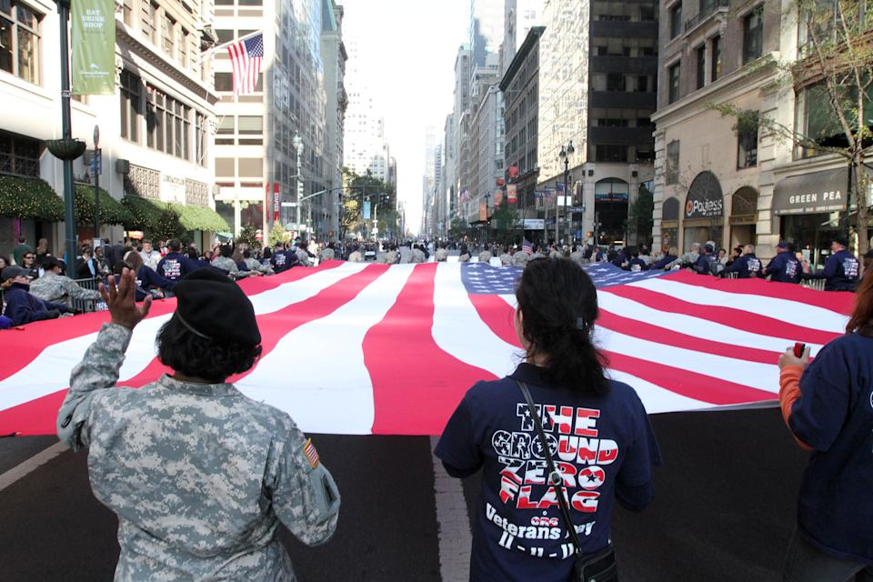 The American flag is carried up New York's Fifth Avenue during the Veterans Day Parade Sunday Nov. 11, 2012. (AP Photo/Tina Fineberg)