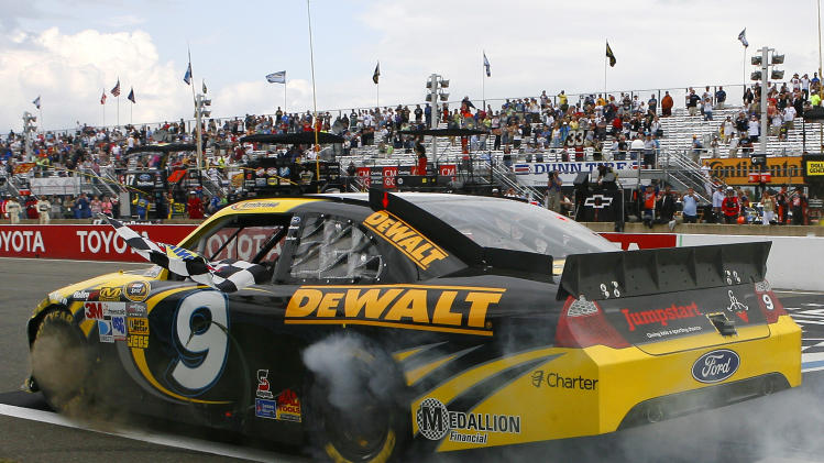 Marcos Ambrose performs a burnout after winning the NASCAR Sprint Cup Series auto race at Watkins Glen International, Sunday, Aug. 12, 2012, in Watkins Glen, N.Y. (AP Photo/Autostock, Russell LaBounty) MANDATORY CREDIT