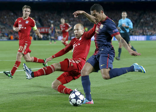 Bayern's Arjen Robben of the Netherlands, left, tries to stop a cross by Barcelona defender Adriano, of Brazil, right, during the Champions League semifinal second leg soccer match between FC Barcelon