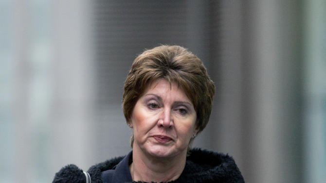Detective Chief Inspector April Casburn of the London Metropolitan Police walks into Southwalk Crown Court in London, Monday, Jan. 7, 2013.  Casburn is accused of offering the now-defunct tabloid, The News of the World information about Operation Varec, the investigation into whether Scotland Yard's inquiry into phone hacking should be reopened. (AP Photo/Alastair Grant)