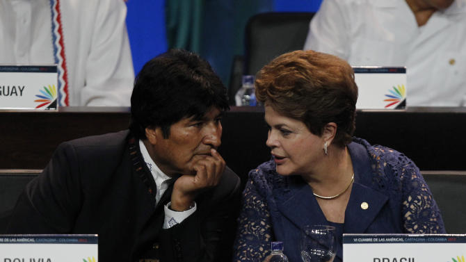 Bolivia's President Evo Morales, left, listens to Brazil's President Dilma Rousseff at the opening ceremony of the sixth Summit of the Americas at the Convention Center in Cartagena, Colombia, Saturday April 14, 2012. The summit brings together presidents and prime ministers from Canada, the Caribbean, Latin America and the U.S. (AP Photo/Fernando Vergara)