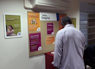 File picture shows a man looking at job information at an employment agency in France. There are now 30 million more people without jobs around the world than before the global financial crisis began, the head of the International Labour Organization said in remarks published Friday